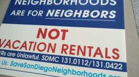 A sign lays on the ground with its message in opposition of short term vacation rentals, July 17, 2018.