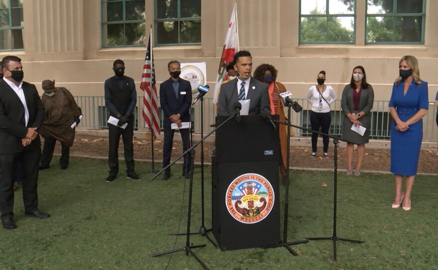 Share Harris of the People's Alliance For Justice speaks outside the county administration building downtown, July 1, 2020.