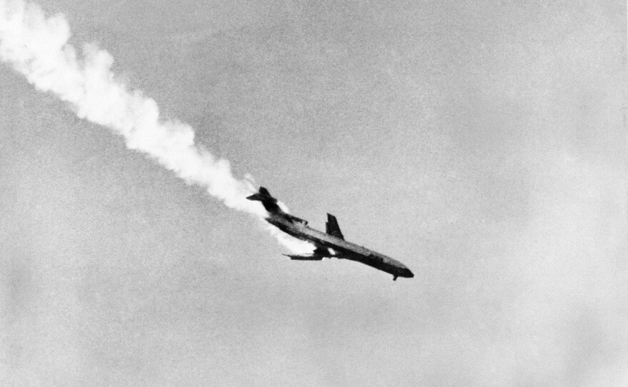 Pacific Southwest Airlines Flight 182, with its wing aflame after a collision with a smaller plane, plunges to earth killing all passengers and crew, in San Diego, Sept. 25, 1978.