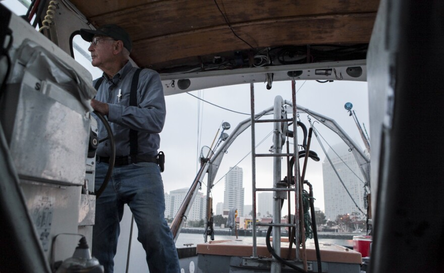 Commercial fisherman Phil Harris steers his boat out of San Diego Bay in August 2016.