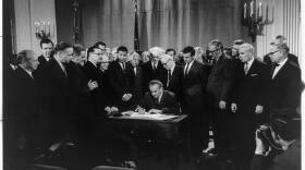 President Lyndon Baines Johnson signs Civil Rights Bill, also known as the Fair Housing Act, April 11, 1968.