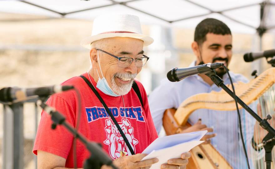Juan Felipe Herrera, former poet laureate of the United States, performs with Los Originarios del Plan at the Madera Flea Market on June 13, 2021.