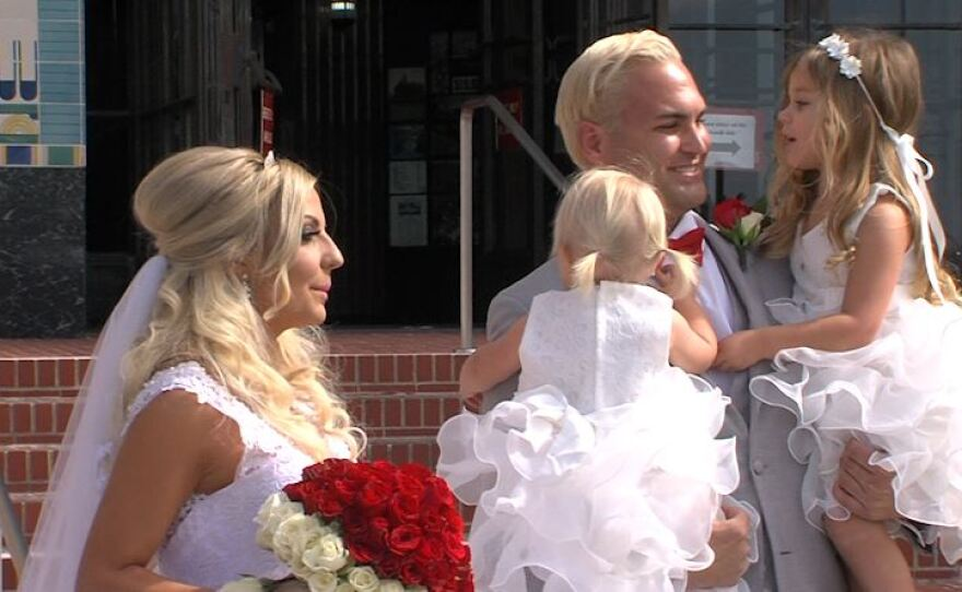 A couple moments before getting married standing outside of the San Diego County Administration building on Feb. 14, 2017.