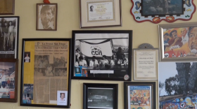 Photos and posters are shown hanging across the walls of Aztec Printing in National City on Jan. 30, 2015.