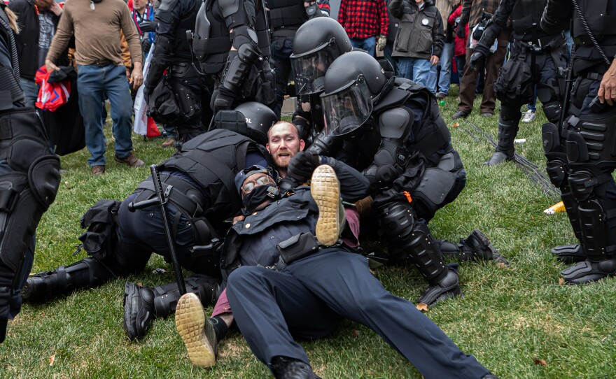 A Pro-Trump protester resists arrest on Wednesday. Hundreds breached the U.S. Capitol Building but there were few arrests in relation to the scope of the unrest as of Wednesday night