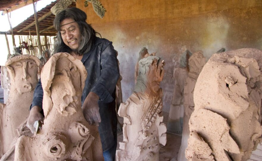 Oaxacan artist Alejandro Santiago (pictured working on clay sculptures) returned to his village after a decade living abroad, only to find abandoned houses, empty streets and deserted farm fields. In response, he created a monumental installation art piece comprised of 2,501 life-size clay sculptures, each representing a migrant who left his village.