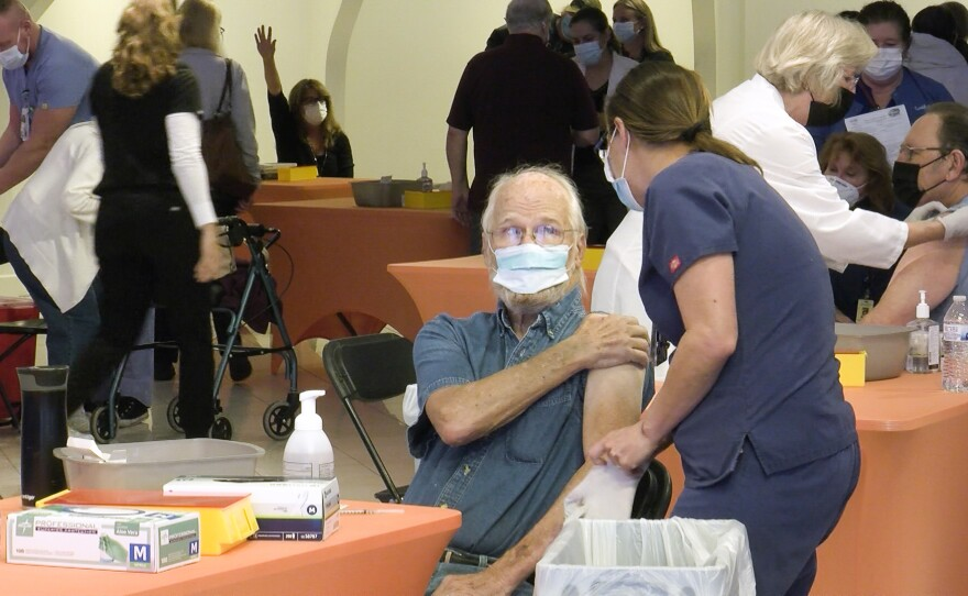 A man receives a COVID-19 vaccine at the vaccination super station at Grossmont Center in La Mesa, Calif. Feb. 2, 2021.