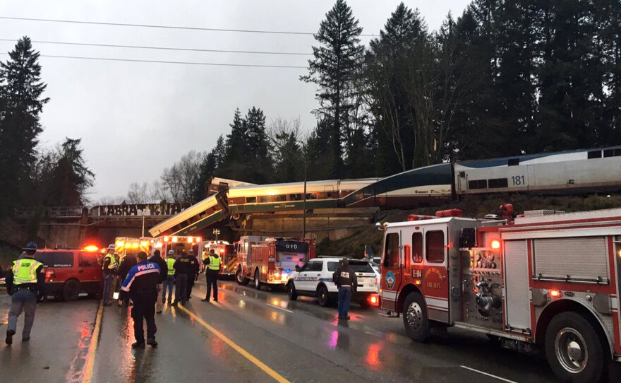 """This photo provided by Washington State Patrol shows an Amtrak train that derailed south of Seattle on Monday, Dec. 18, 2017. Authorities reported """"injuries and casualties."""" The train derailed about 40 miles (64 kilometers) south of Seattle before 8 a.m., spilling at least one train car on to busy Interstate 5."""