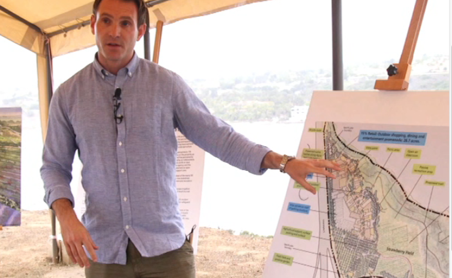 Caruso Vice President Bryce Ross, with a map of the proposed Agua Hedionda 85/15 Project. July 2015