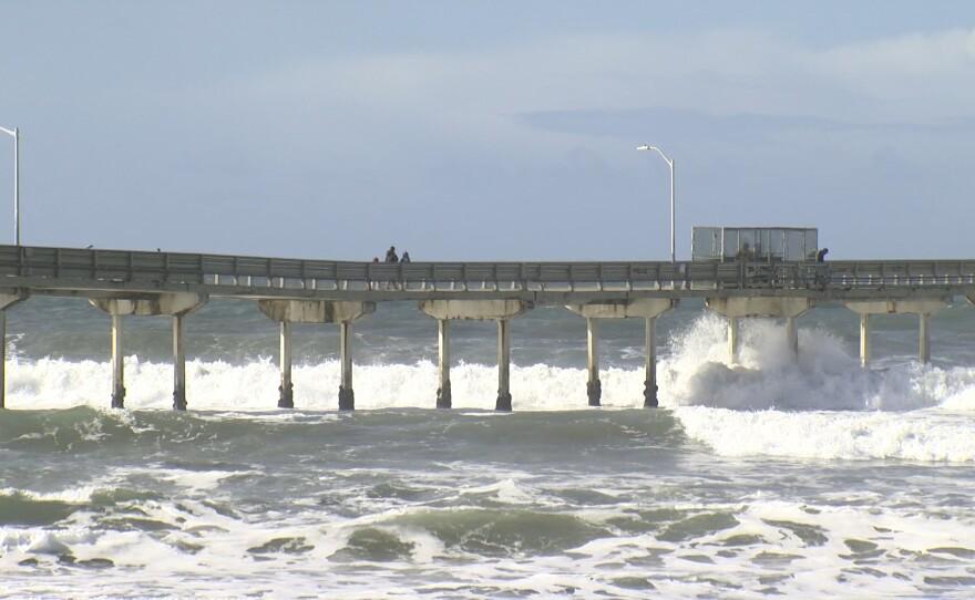 Waves crash against the Ocean Beach Pier in San Diego County. Dec. 28, 2020.