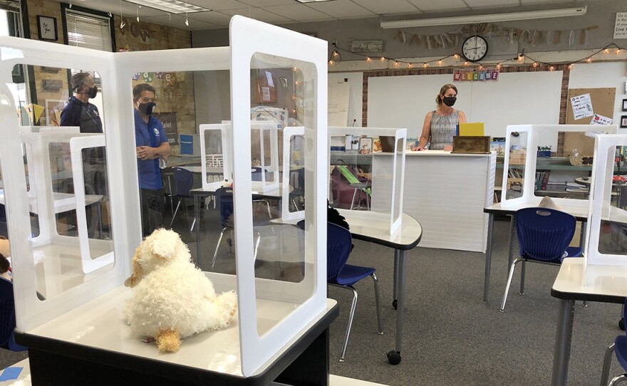 Inside of a classroom at Blossom Valley Elementary in El Cajon with plastic dividers sitting on desks, August 28, 2020.