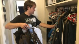 Nathan Donovan goes through his costumes in preparation for Comic-Con.