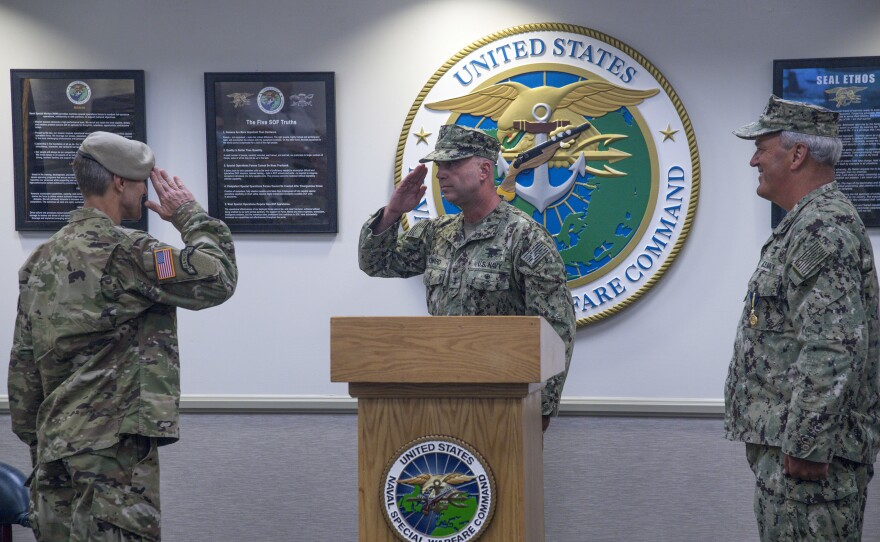 Rear Adm. H. W. Howard III, center, assumes command of Naval Special Warfare Command, saluting U.S. Army General Richard D. Clarke, commander, United States Special Operations Command (USSOCOM), as Rear Adm. Collin P. Green, the outgoing NSWC commander, Sept. 11. 2020