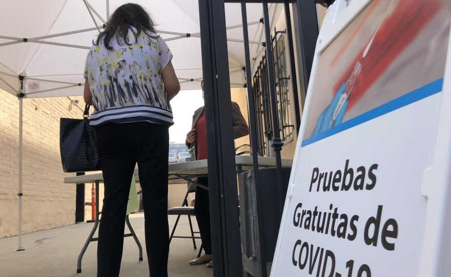 A woman checking in at a new COVID-19 testing at the Mexican Consulate in downtown San Diego on Sept. 14, 2020.
