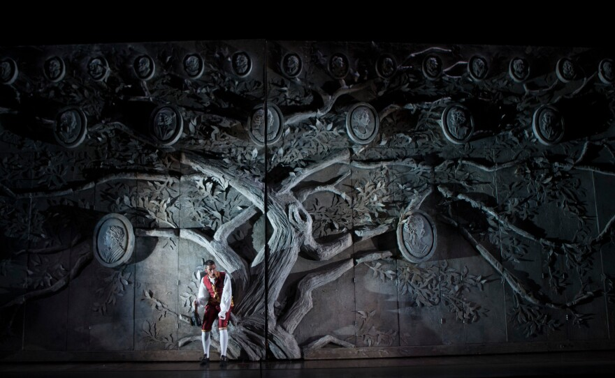 """Evan Hughes as Figaro in front of the impressive set for San Diego Opera's production os Mozart's """"The Marriage of Figaro."""""""