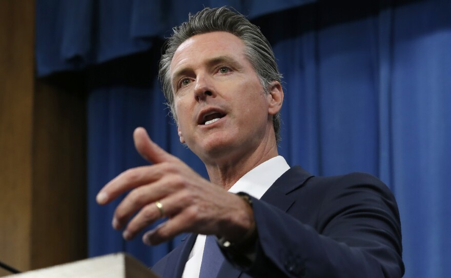 In this July 23, 2019, file photo, Gov. Gavin Newsom talks to reporters at his Capitol office in Sacramento, Calif.