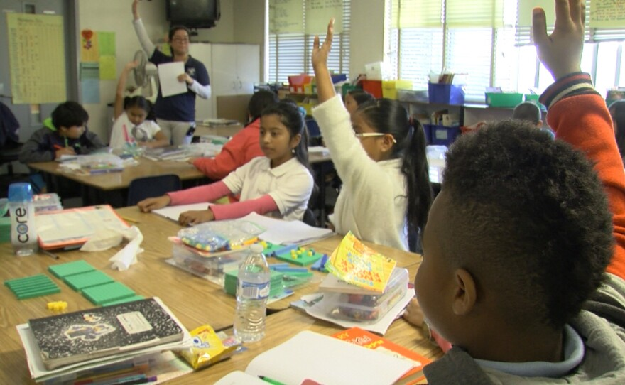 Donnell Branch, right, raises his hand in his Perkins Elementary Schoool fourth-grade classroom, March 2, 2017.