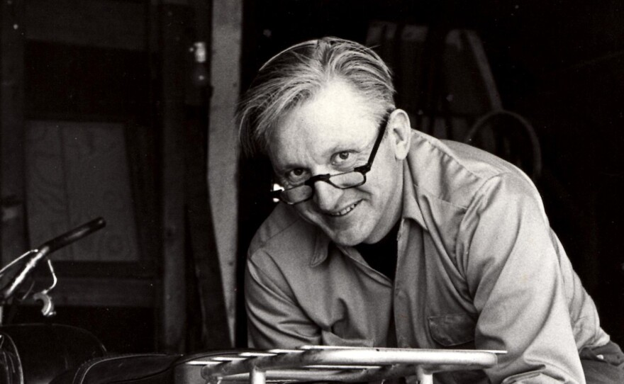 Author Robert Pirsig works on a motorcycle in 1975.