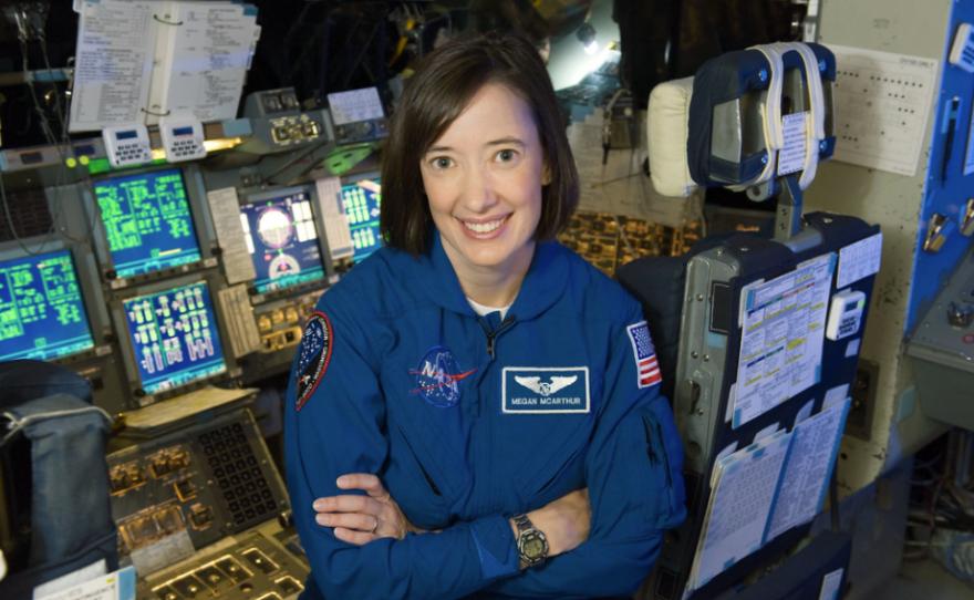 Scripps Institution of Oceanography Alumna and astronaut Megan McArthur, in blue flight suit, taken in Bldg. 5 Motion Based Simulator.