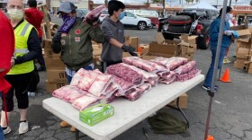 Volunteers wait to giveaway beef roasts for Easter dinner in Escondido. April 11, 2020.