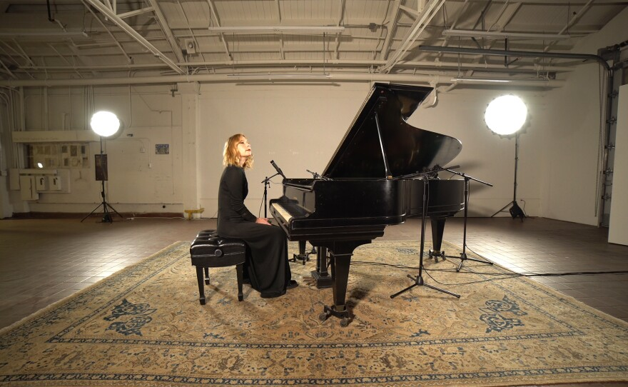 Pianist and vocalist Carrie Feller is pictured recording in the Athenaeum Art Center earlier this year. Her performance is part of the Logan Lone Piano Concerts series, viewable on demand beginning Apr. 1, 2021.