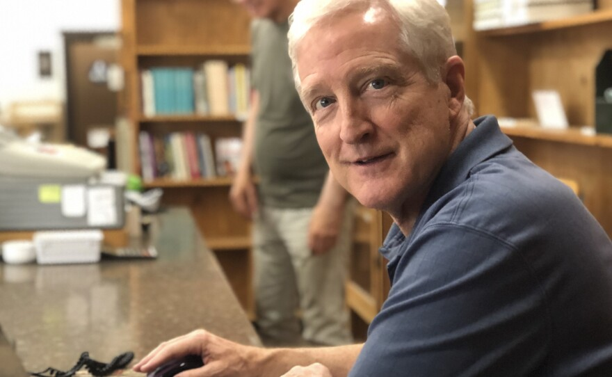 Adams Avenue Book Store owner Brian Lucas works on his laptop near the front of the store, July 13, 2018.