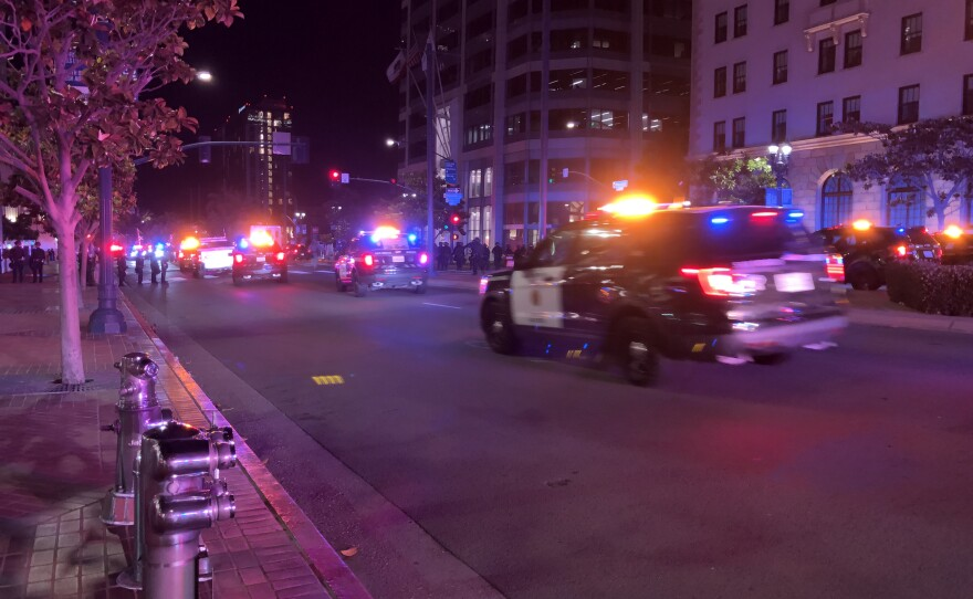San Diego police cars race through downtown during a demonstration, May 31, 2020.
