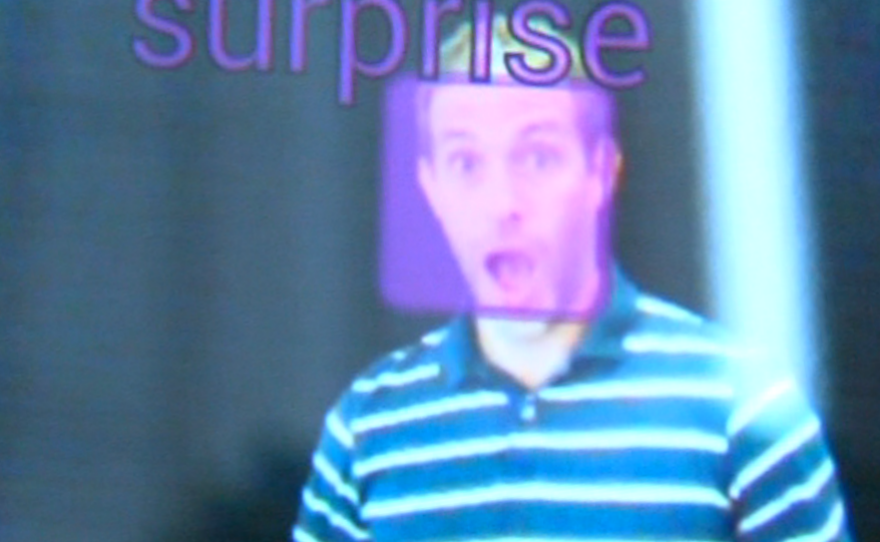 A purple box signifying a surprised expression is superimposed on the image of Emotient researcher Josh Susskind's face.