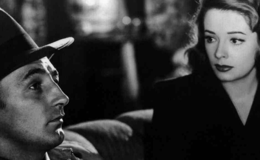 """Robert Mitchum plays a former private detective whose past comes back in the shape of Jane Greer's lethal femme fatale in """"Out of the Past."""""""