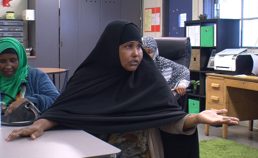 Mariam Ali, a parent of a Crawford High School student, discusses the benefits of halal school lunches with school administrators and students May 15, 2015.