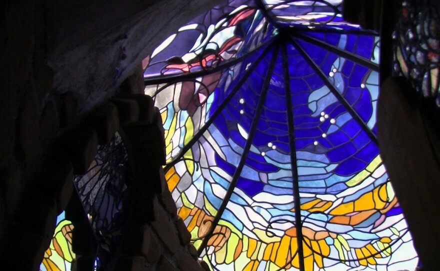 Stained glass designed by artist Jim Hubbell adorns one of the buildings on his Julian property, April 11, 2017.