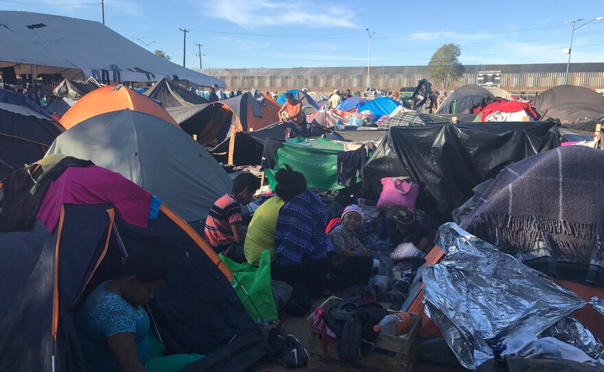 Migrants rest at the Tijuana sports facility Benito Juarez, which has been turned into a makeshift shelter, Nov. 27, 2018.