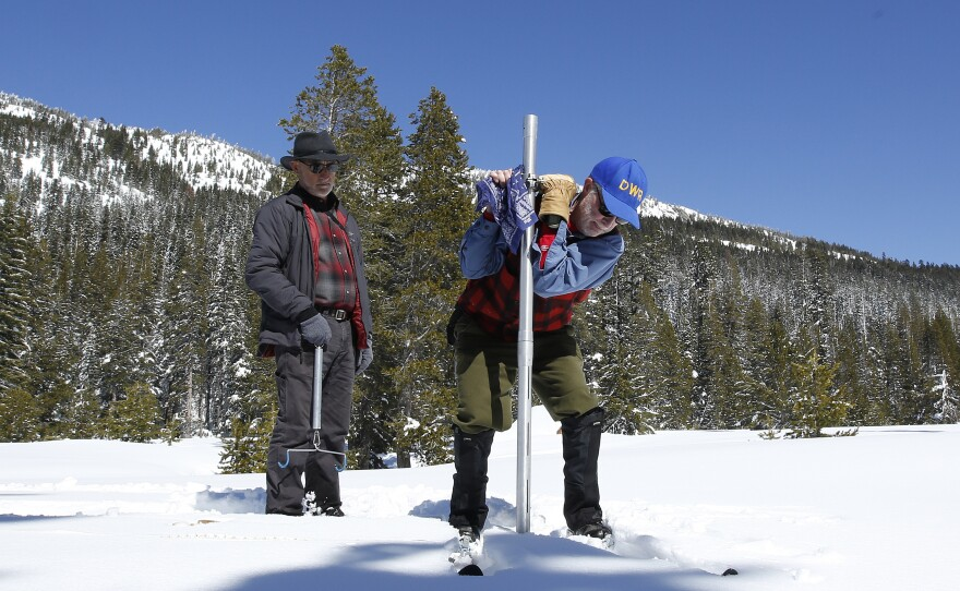 Frank Gehrke, right, chief of the California Cooperative Snow Surveys Program for the Department of Water Resources, plunges the survey tube into the snowpack as he conducts the third manual snow survey of the season at Phillips Station, Wednesday, March 1, 2017.