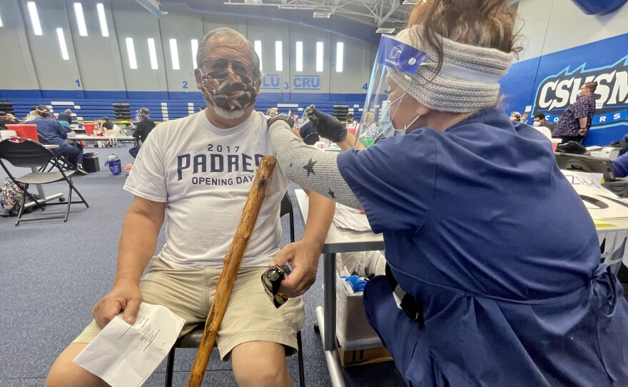 Lawrence Mendoza from Vista get his COVID-19 vaccination at CSU San Marcos, Feb. 22, 2021.