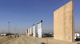 Border wall prototypes on display in San Diego, where contractors offer different designs.