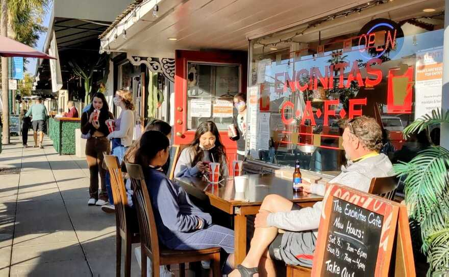Patrons dining in front of Encinitas Cafe on Jan. 3, 2021, which was opened in violation of the regional stay-at-home order.