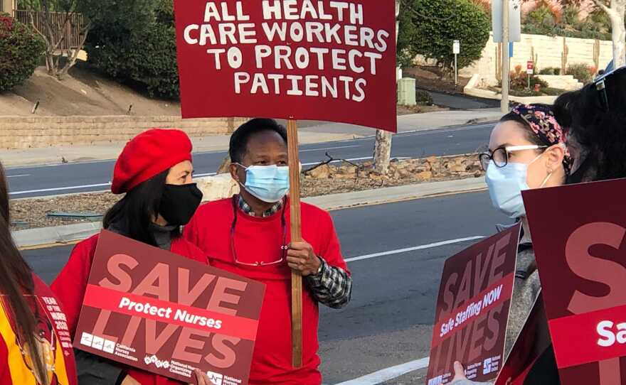Nurses protesting outside Palomar Medical Center Poway on Dec. 11, 2020, over what they say are unsafe working conditions during the coronavirus pandemic.