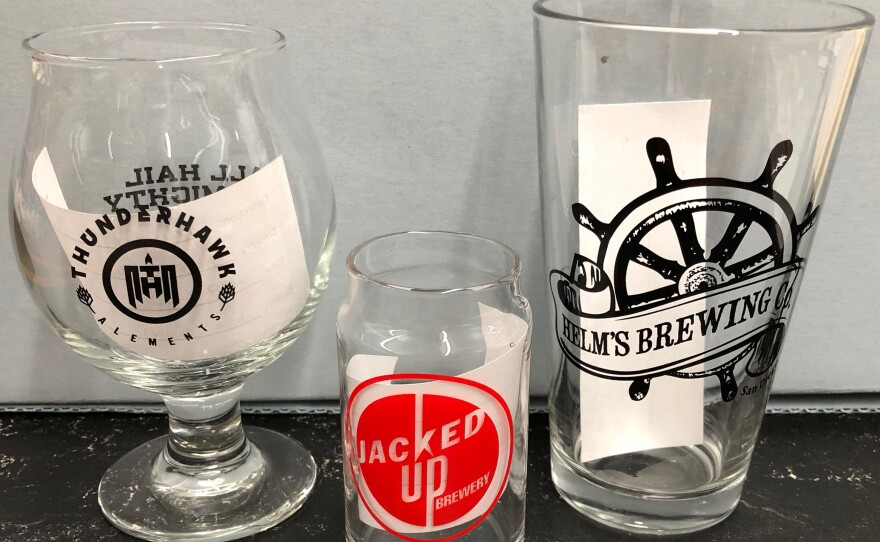 """This glassware from the """"Brewchive"""" is a sample of the different shapes of glassware used at local breweries."""