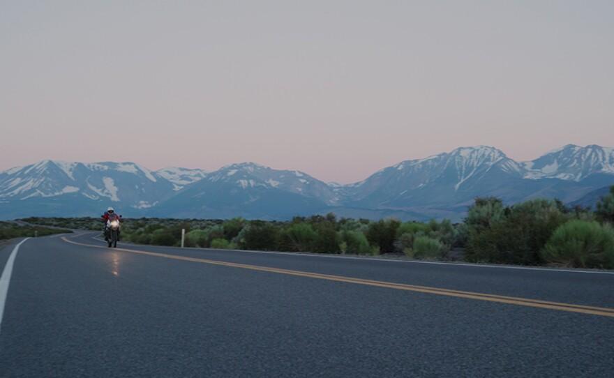 Biker rides through California as the sun rises.