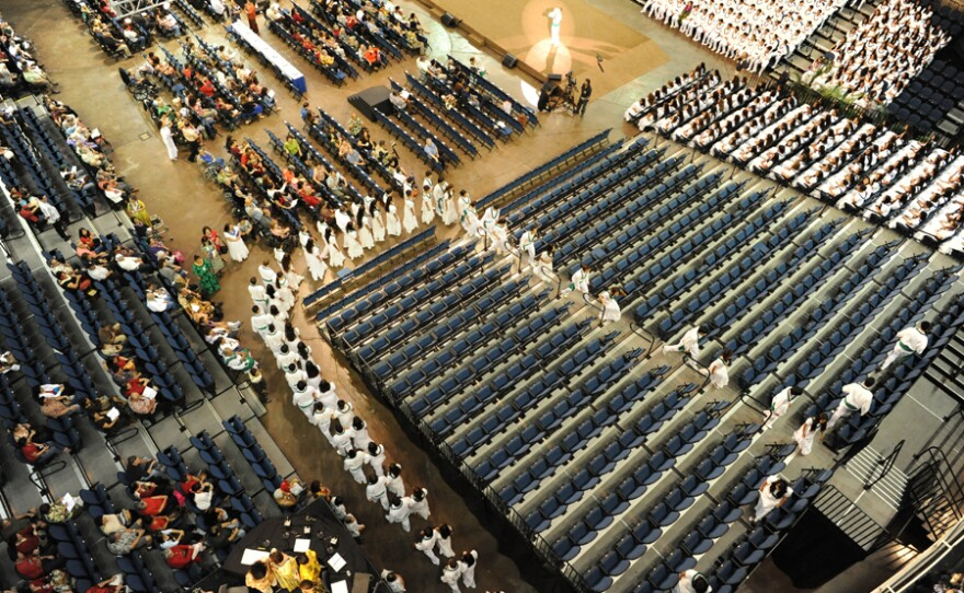 Aerial view of the Kamehameha Schools Song Contest as it begins. Every year in Hawai'i, 2,000 high school students compete in the Kamehameha Schools Song Contest, in which young leaders direct their peers in singing Hawaiian music in four-part harmony.