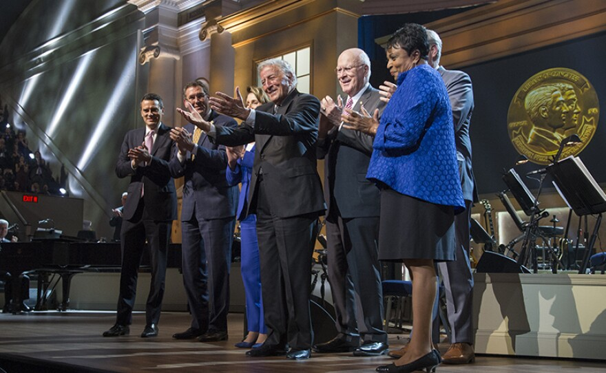 Honoree Tony Bennett at the presentation of the Library of Congress Gershwin Prize for Popular Song. Presenting Members of Congress are (l-r) U.S. Representative Kevin Yoder, U.S. House of Representatives Vice Chairman of the Joint Committee on the Library of Congress Gregg Harper, U.S. House of Representatives Democratic Leader Nancy Pelosi, U.S. Senator Patrick Leahy, and U. S. House of Representatives Majority Leader Kevin McCarthy, with Librarian of Congress Carla Hayden, far right.