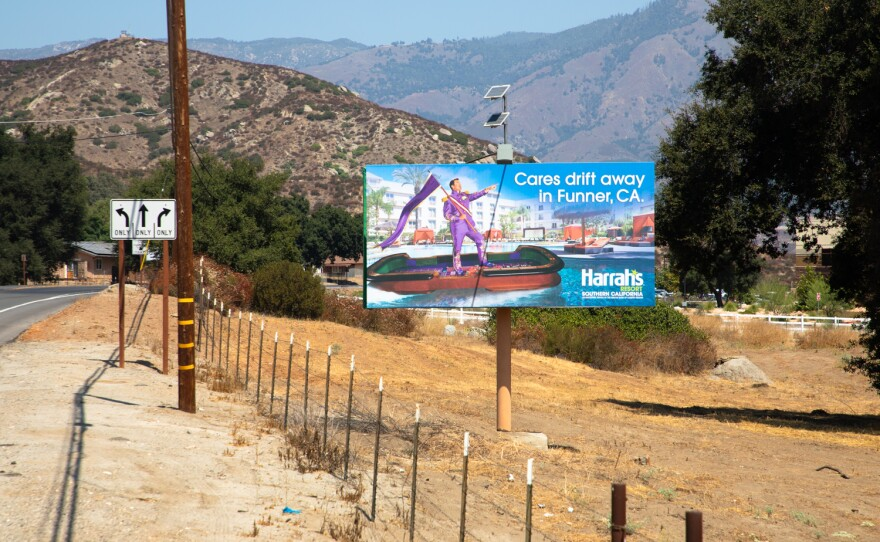 A sign for Harrah's Resort Southern California advertises for the casino along Valley Center Road, Sept. 3, 2020.