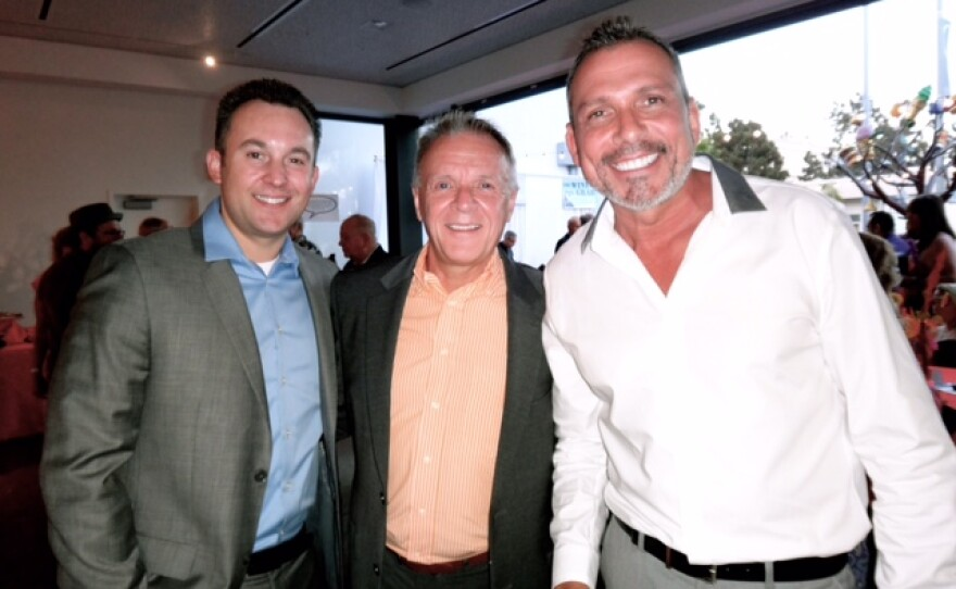 Rev. Ogle is flanked by 2013 LGBT Pride Month Local Heroes, Vincent Pompei of the Human Rights Campaign, and Max Disposti, Executive Dir., North County LGBTQ Resource Center at its recent gala.