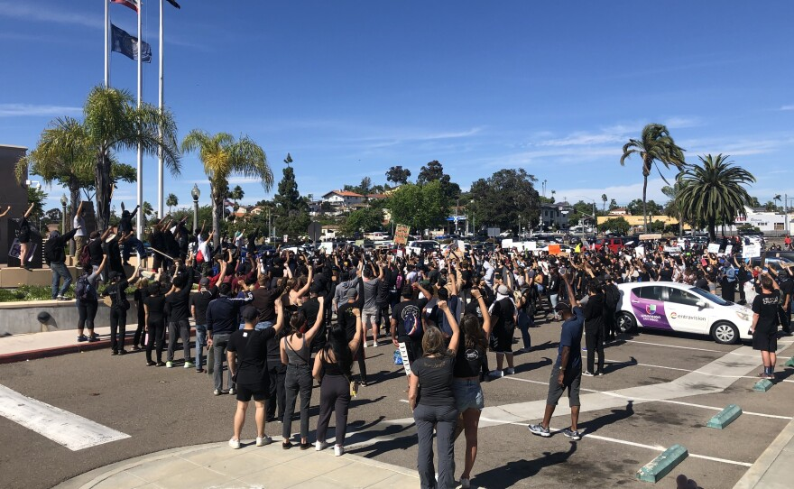 A crowd of protesters gather at the La Mesa Police Department during a demonstration, May 30, 2020.