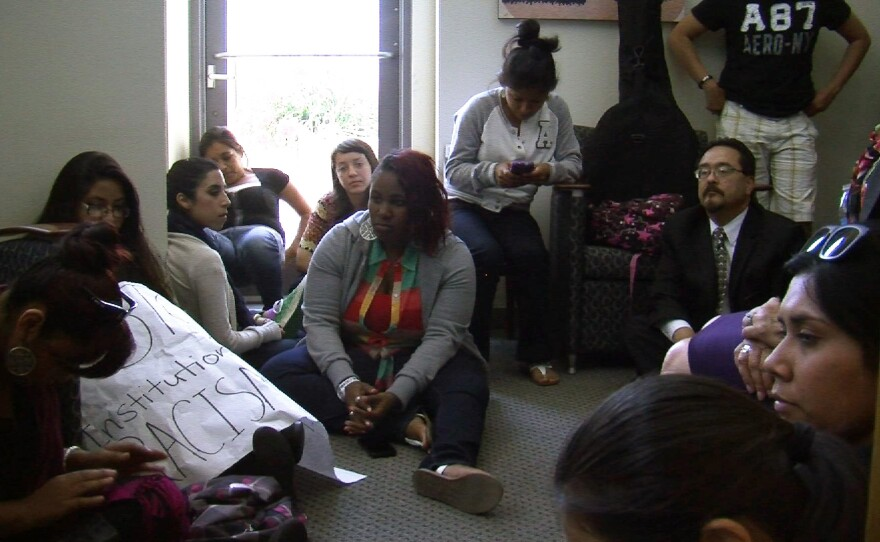 Students, as well as a few faculty and staff, protesting the California State University San Marcos administration's response to an incident where Sorority members posted photos of themselves posing as 'cholas,' or Latina gang members, on social media. They staged a sit-in outside the university president's office Thursday, May 9, 2013.