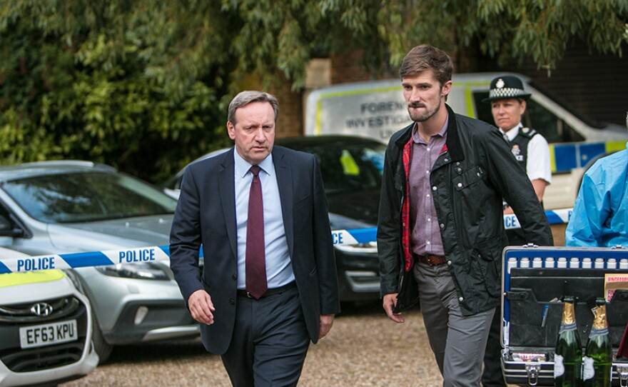 """Detective Chief Inspector John Barnaby (Neil Dudgeon) and Detective Sergeant Charlie Nelson (Gwilym Lee) in a scene from MIDSOMER MURDERS """"A Vintage Murder."""""""