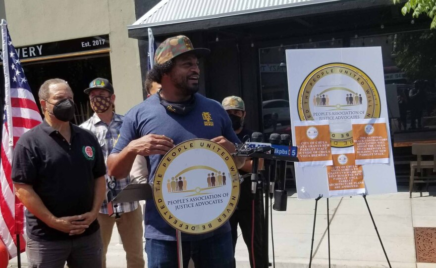 Timothy Parker, owner of Chula Vista Brewery addresses the media about being granted a new parklet from the city of Chula Vista in front of the brewery on Sept. 1, 2021.