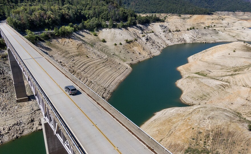 A car crosses Enterprise Bridge over Lake Oroville's dry banks in Oroville, Calif., May 23, 2021,.