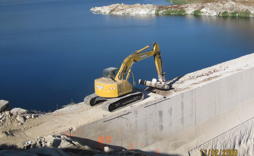 The San Diego County Water Authority has been upgrading its existing water storage facilities in an effort to decrease reliance on the Metropolitan Water Authority. This photo shows construction at the San Vicente Dam to remove the right crest of the dam to increase the size of the reservoir, November 2009.