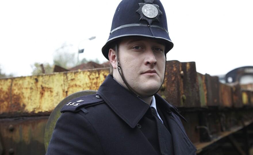 Sean Rigby as PC Strange.